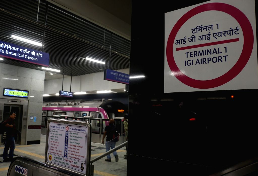 A Delhi metro rake at Terminal 1-IGI Airport metro station on Delhi metro's magenta line that is scheduled to be thrown open to the public on May 29, during a trial run in New Delhi on May ...