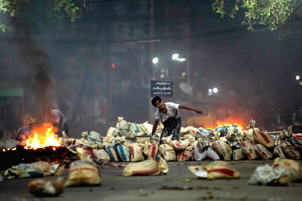 A demonstrator stacks bags on a street as a barricade during a demonstration against the military coup and the detention of civilian leaders. Photo: Theint Mon Soe/SOPA Images via ZUMA Wire/dpa/IANS
