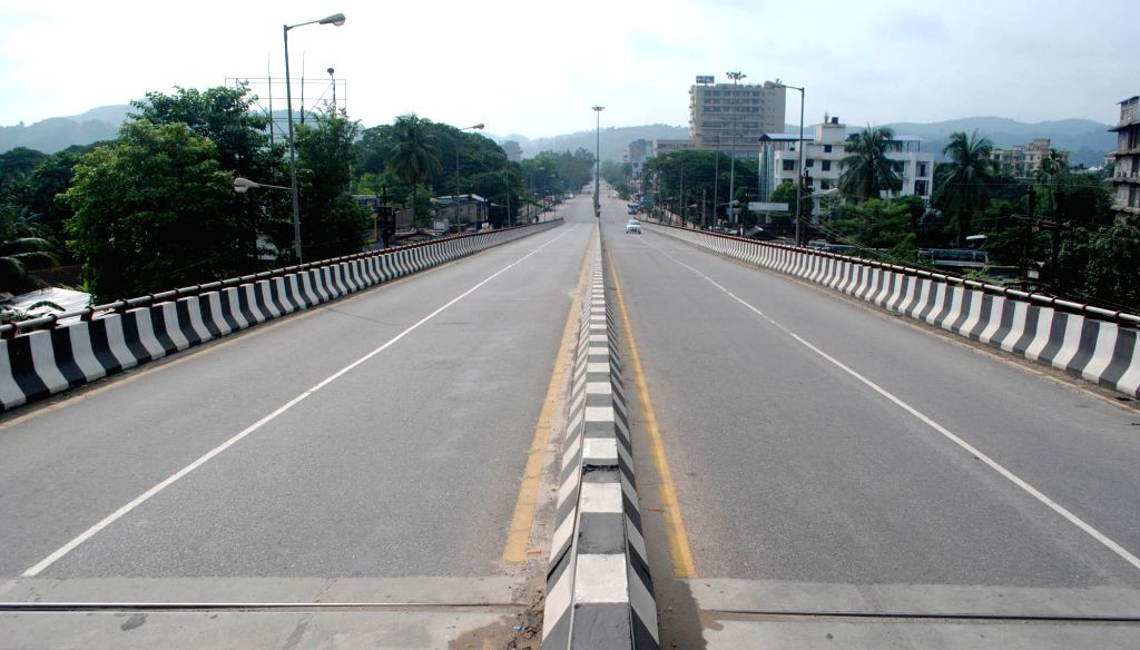 A deserted road of Guwahati during a 12-hour Assam bandh, called by Assam Gana Parishad (AGP) to protest against recent violence in Golaghat of Assam, in Guwahati on Aug 21, 2014.