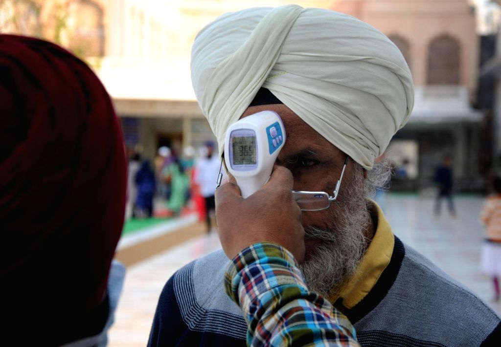 A devotee being screened for COVID-19 amid coronavirus pandemic, at the Golden Temple in Amritsar on March 18, 2020.