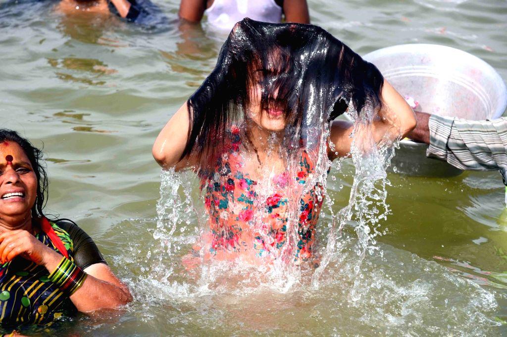 A devotee takes a holy dip during Krishna Pushkaralu river festival at Durga ghat in Vijayawada on Aug 15, 2016.