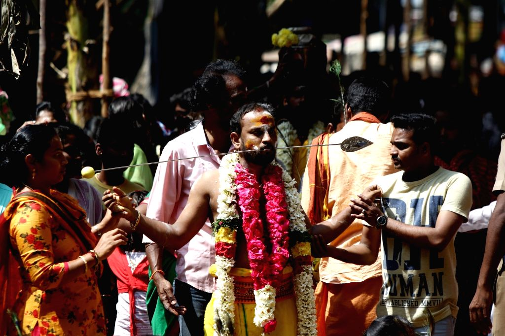 A devotee undertakes a procession towards the Murugan temple during Thaipusam celebrations, in Chennai on Feb 8, 2020.