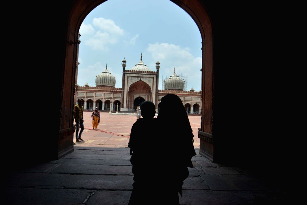 A devotee with her child at Delhi's Jama Masjid during Unlock 2.0, on July 10, 2020.