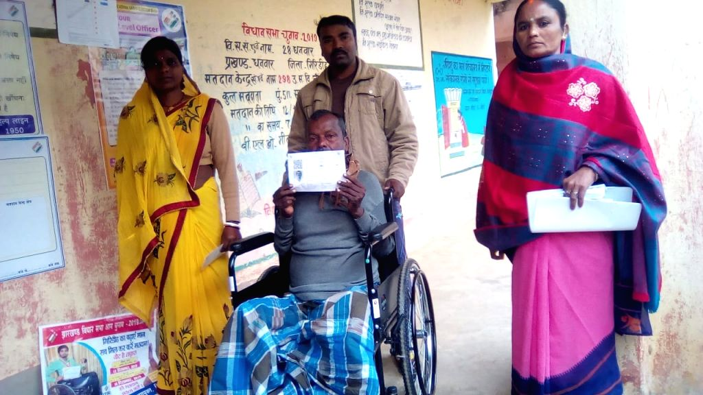 A differently able voter arrives to cast his vote at a polling station during the third phase of Jharkhand Assembly elections, at Dhanwar in Giridih district on Dec 12, 2019.