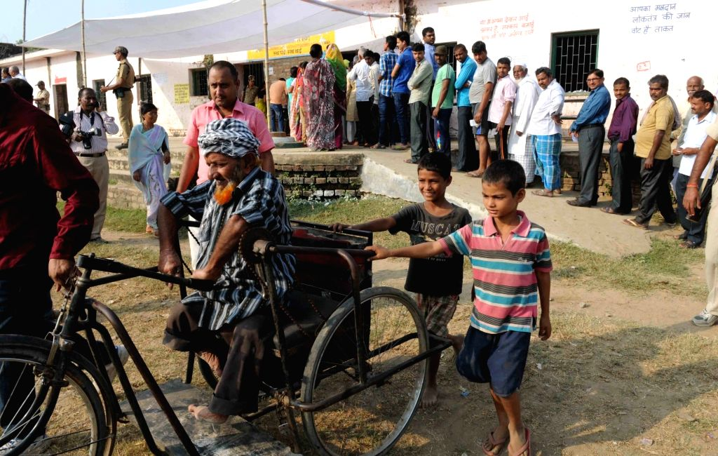 A differently abled person arrives to cast his vote at a polling booth during the third phase of Bihar assembly polls in Patna on Oct 28, 2015.