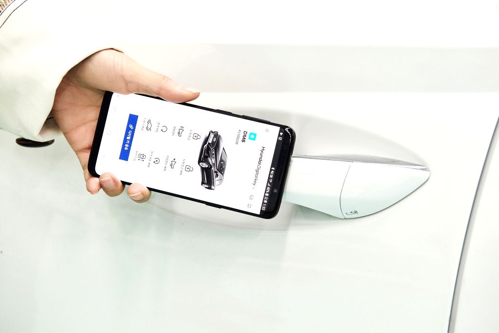 A digital key, which can lock and unlock a car using a downloaded app on a smartphone, is shown in this photo from Hyundai Motor and its sister firm, Kia Motors, on March 4, 2019. The ...