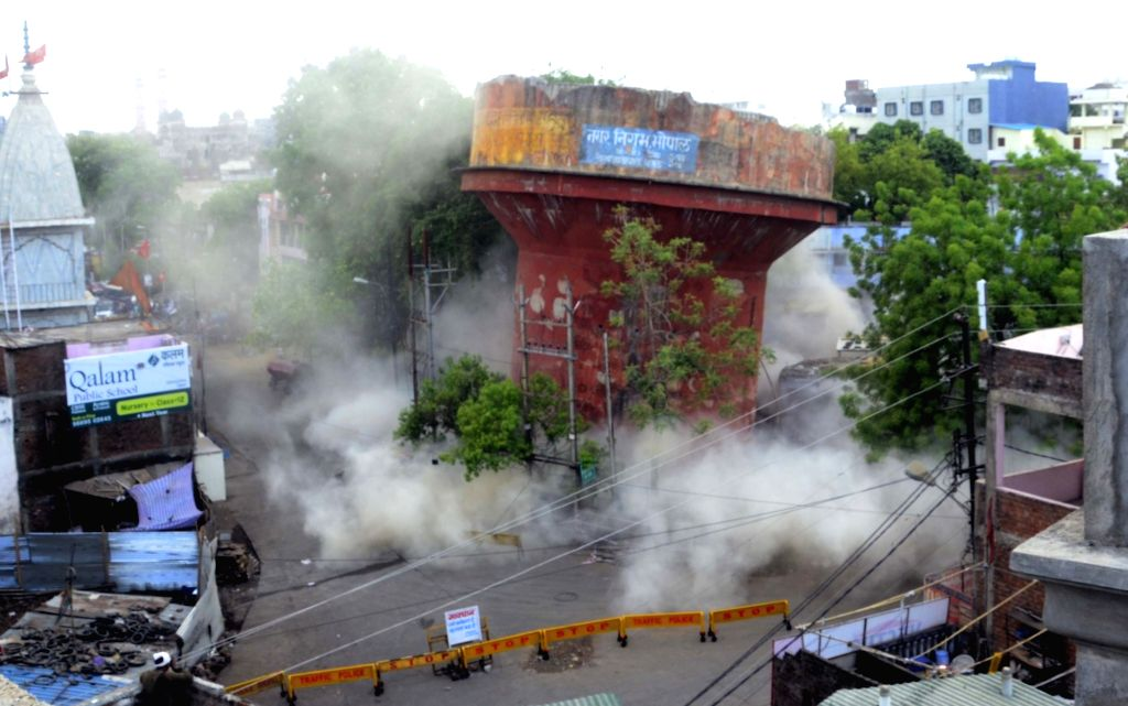 A dilapidated overhead water tank being demolished by Bhopal Municipal Corporation on June 13, 2019.