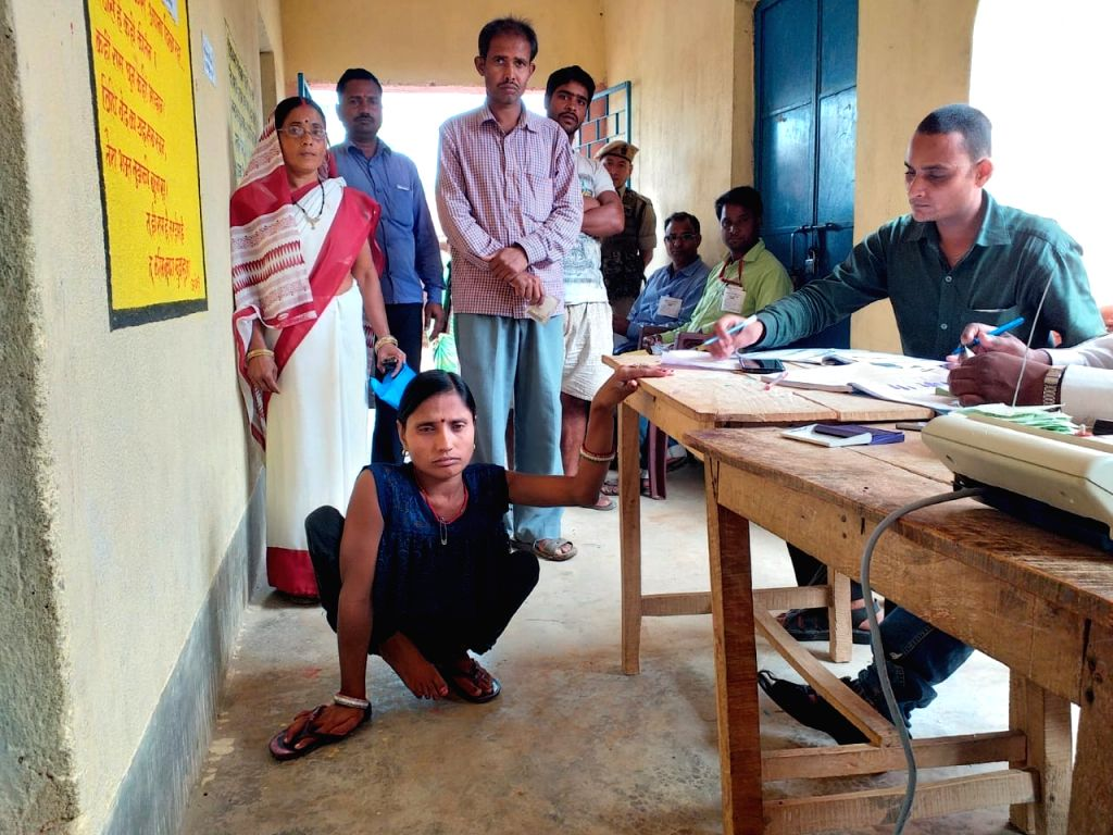 A disabled woman at a polling station to cast vote for Lok Sabha election, in Bihar's Jamui, on April 11, 2019.