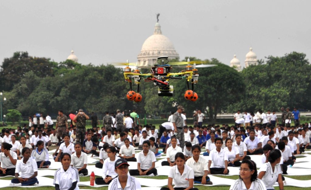 A drone being used to keep an eye on people practicing Yoga Asans  -postures- on International Yoga Day in Kolkata on June 21, 2017.