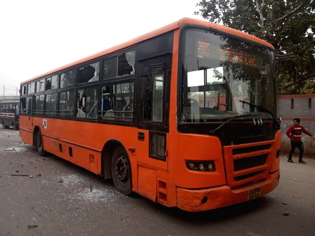 A DTC bus that got damaged after a protest against the Citizenship Amendment Act (CAA) 2019 turned violent after protesters pelted stones at police personnel, in North East Delhi's ...