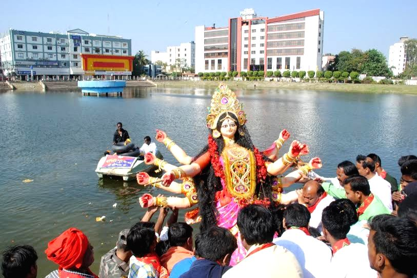 A Durga idol being immersed in the Ranchi Lake, on Oct 24, 2015.