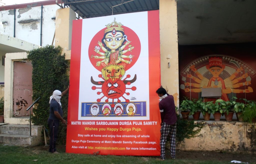 A Durga Puja pandal on the unique theme of 'Coronasur Badh' (killing of monster Corona) being given final touches ahead of Durga Puja celebrations, at Safdarjung Matri Temple in New Delhi ...