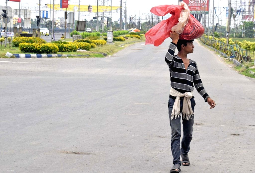 A farmer carries his produce to the market during the extended nationwide lockdown imposed to mitigate the spread of coronavirus; on Apr 26, 2020.