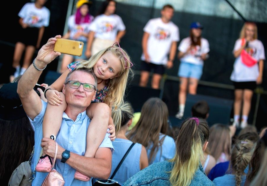 A father takes selfie with his daughter during a TikTok filming session in Vilnius, Lithuania, Aug. 10, 2020.