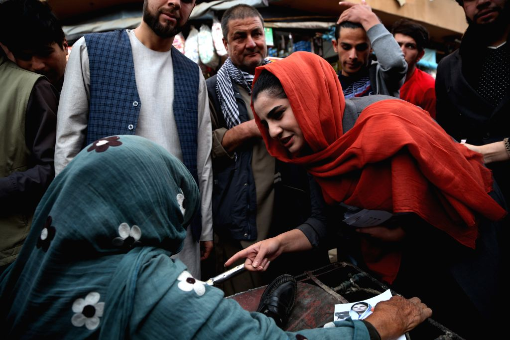 : A female parliamentary election candidate, Maryam Sama (R), campaigns on a street in Kabul, capital of Afghanistan, Oct. 13, 2018. During the upcoming polls, ...