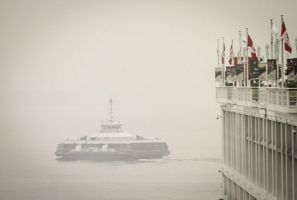 A ferry is seen travelling on the water in heavy smog in Vancouver, British Columbia, Canada, Sept. 13, 2020. As smoke from U.S. wildfires continues to blow ...