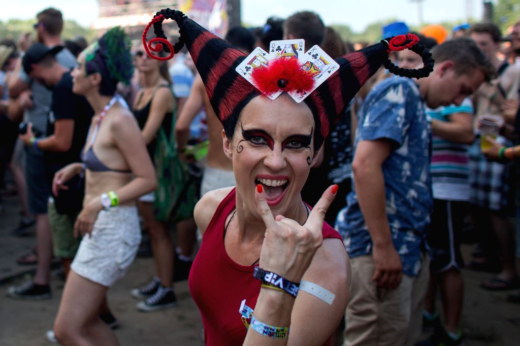 """A festival-goer enjoy music during the Sziget (Hungarian for """"Island"""") Festival on the Obuda Island in Budapest, Hungary, on August 12, 2015. The 23rd ..."""