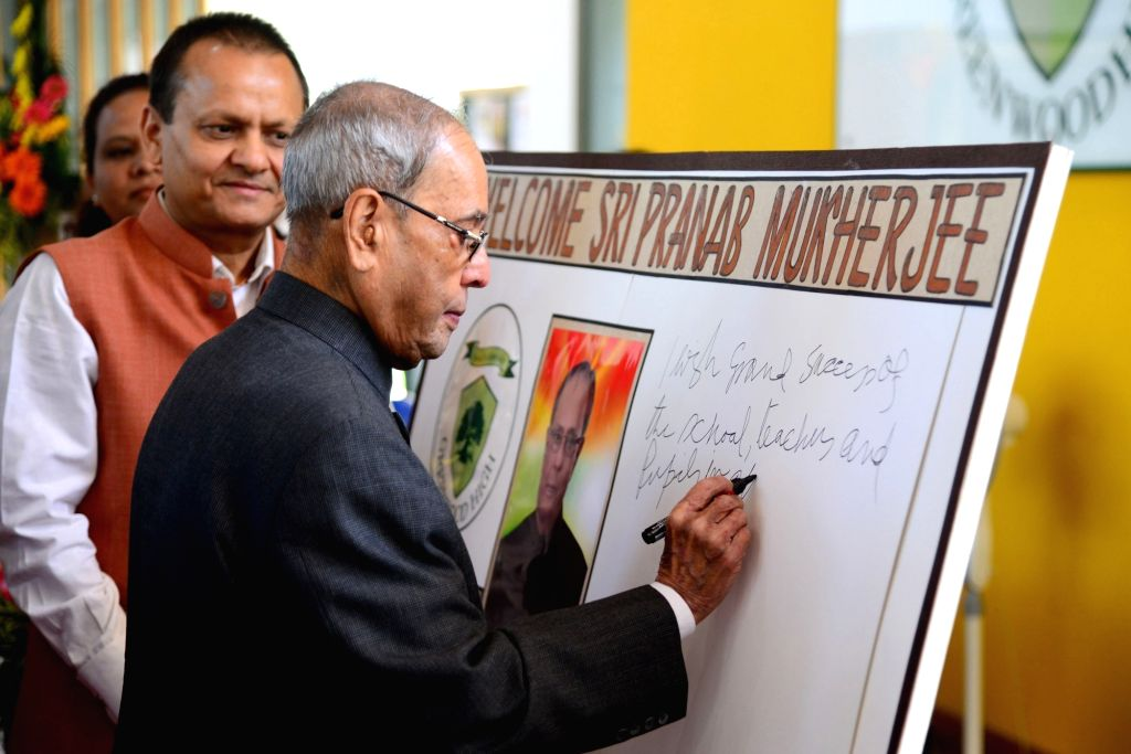 A file photo of then President of India Pranab Mukherjee writing an autograph during his interaction programme with the students of Greenwood High International School. Mukherjee passed away on ... - Pranab Mukherjee