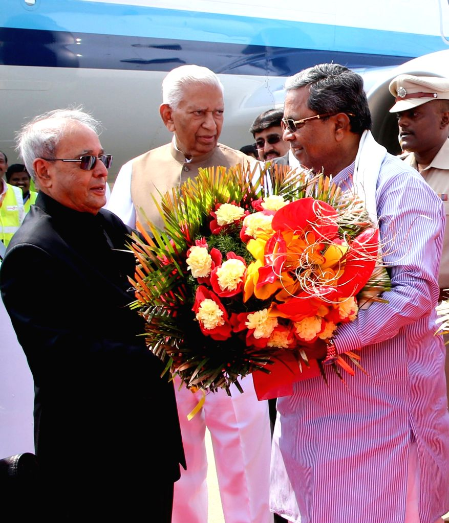 A file photo of then President of India Pranab Mukherjee being welcomed by Karnataka Governor Vajubai Rudabhai Vala and Chief Minister Siddaramaiah at HAL Airport. Mukherjee passed away on Monday ... - Siddaramaiah and Pranab Mukherjee