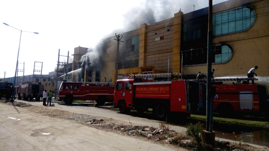A fire breaks-out at a publication house in Sector-59, of Faridabad on April 10, 2016.
