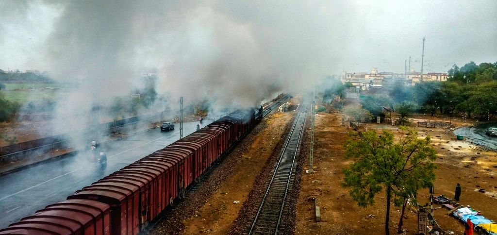 A fire breaks out in the engine of a goods train in Jaipur on June 12, 2019.