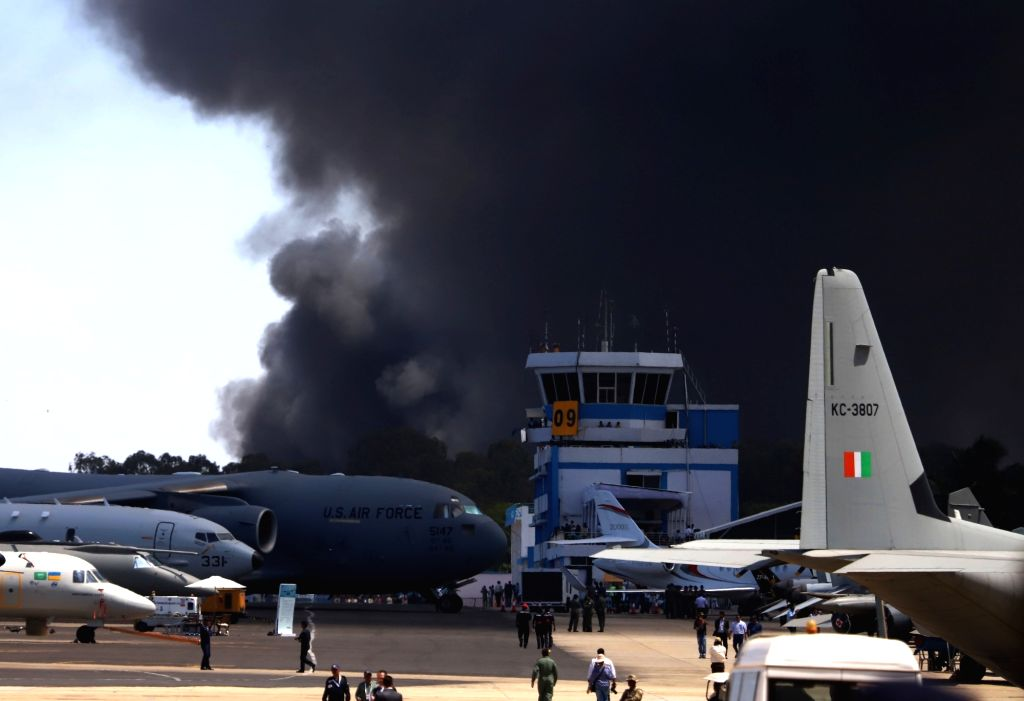 A fire breaks out in the parking lot in front of Yelahanka Air Force Station gutting 100 cars, in Bengaluru on Feb 23, 2019.