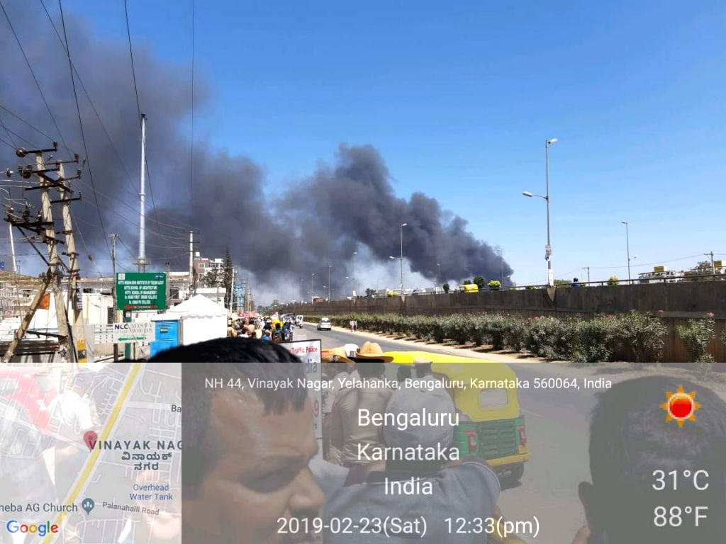 A fire breaks out in the parking lot in front of Yelahanka Air Force Station gutting 300 cars, in Bengaluru on Feb 23, 2019. The fire, which began around 12 noon, quickly burnt down the ...