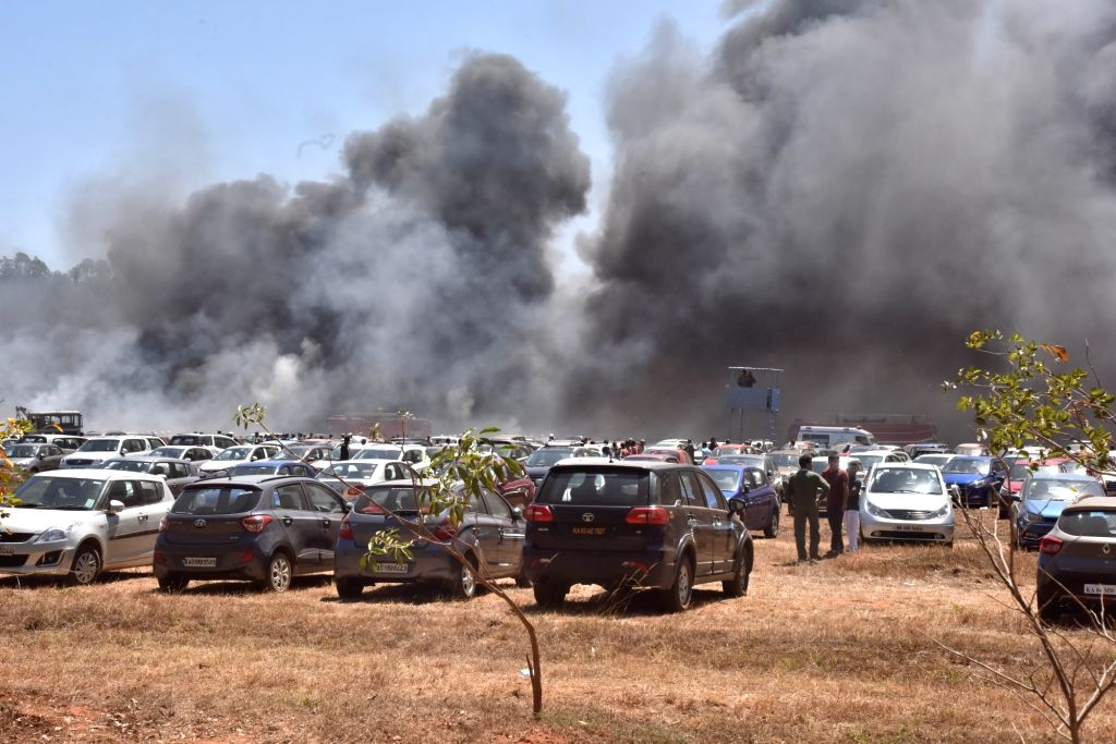 A fire breaks out in the parking lot in front of Yelahanka Air Force Station gutting 300 cars, in Bengaluru on Feb 23, 2019.
