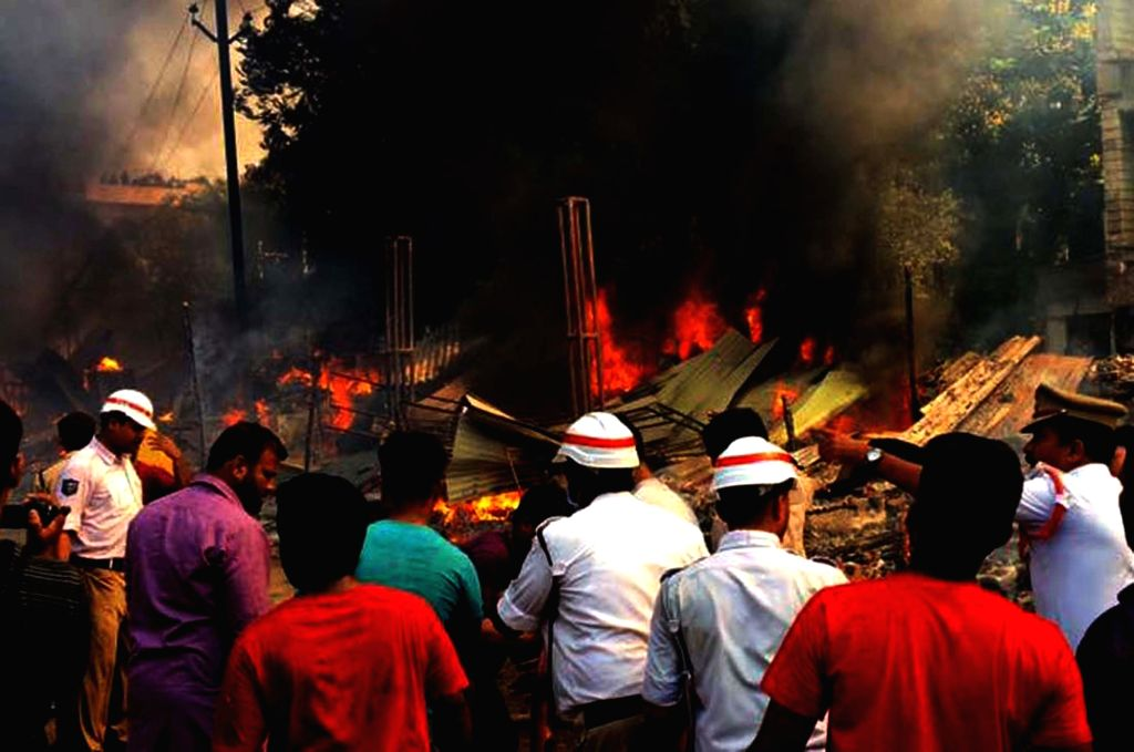 A fire breaks out near Exhibition Ground in Hyderabad destroying around 30 huts in Hyderabad on April 14, 2017.