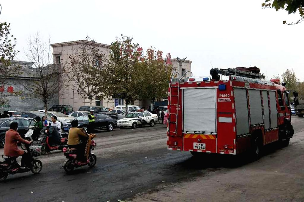 : A fire truck parks outside the Longyun coal mine, the site of a rock burst accident where 22 workers were trapped, in Yuncheng County, east China's Shandong ...