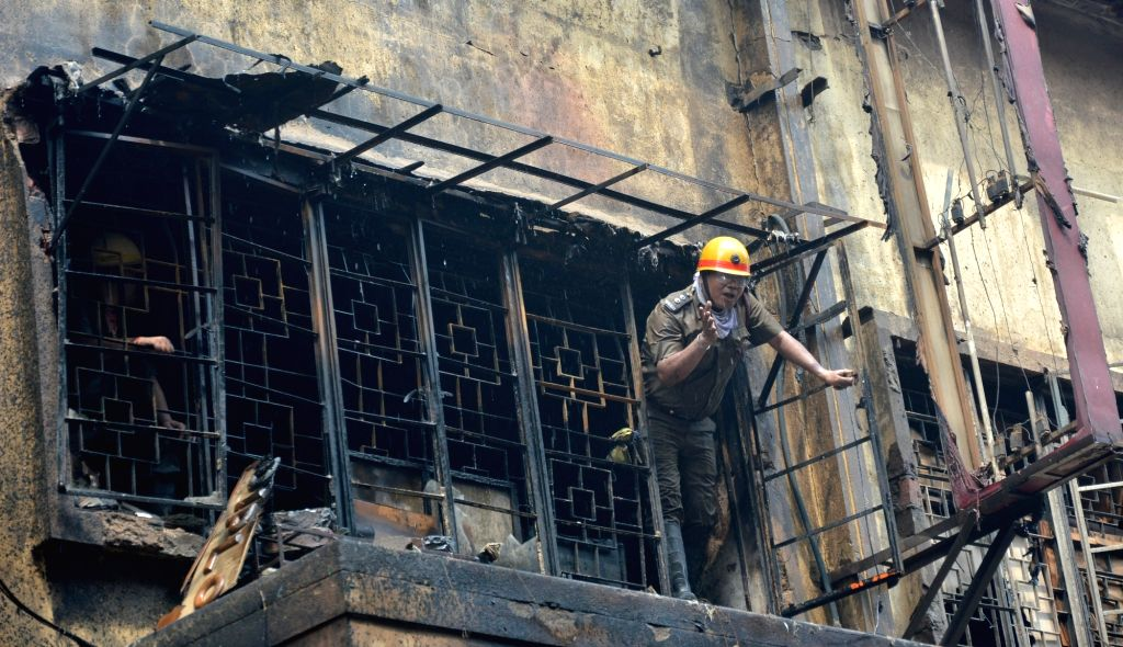 A firefighter during firefighting operations at Bagree market where a fire broke out on Sunday; in Kolkata on Sept 18, 2018.