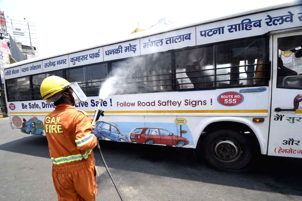 A firefighter sanitises vehicles waiting at a traffic signal in Patna during the extended nationwide lockdown imposed to mitigate the spread of coronavirus; on Apr 23, 2020.