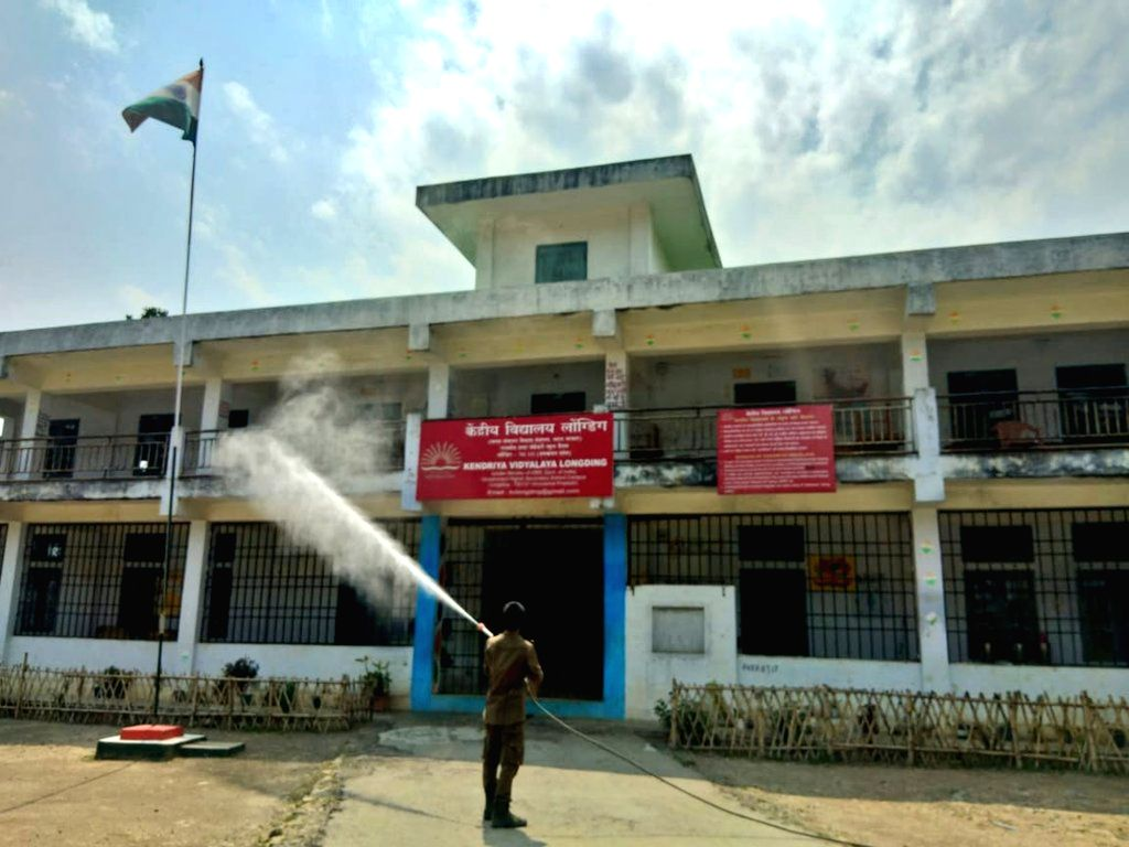 A firefighter sprays disinfectant at Longding in Arunachal Pradesh during the 21-day nationwide lockdown imposed as a precautionary measure to contain the spread of COVID-19 (coronavirus), ...