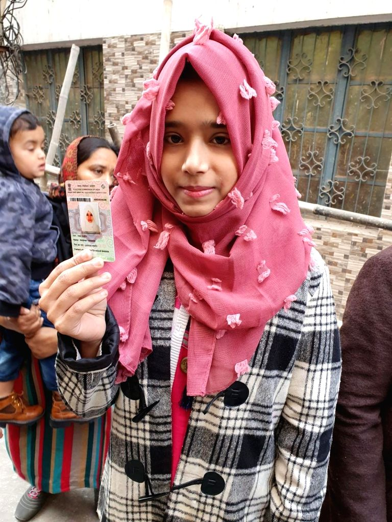 A first time voter shows her Voter ID during Delhi Assembly elections 2020, at a polling station at Delhi's Shaheen Bagh on Feb 8, 2020.