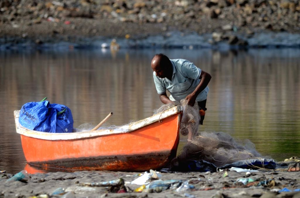 A fisherman busy cleaning his boat during the 41-day annual fishing ban in Maharashtra, in Mumbai on June 3, 2019.