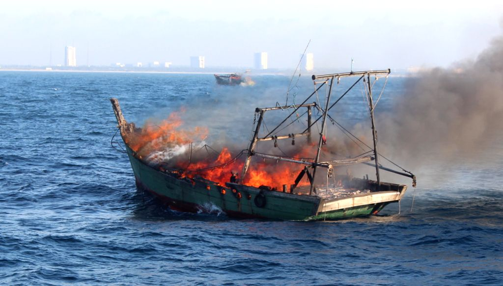 A fishing vessel is on fire as it was sailing six nautical miles off the coast of Wenchang, south China's Hainan Province, Aug. 17, 2015. One fisherman was trapped ...