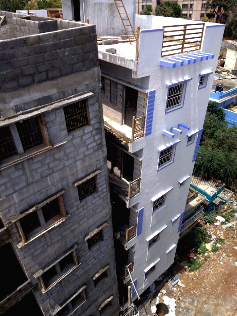 A five-storey building in the narrow bylanes of Ejipura tilted after heavy rains in Bengaluru on Aug 16, 2017.