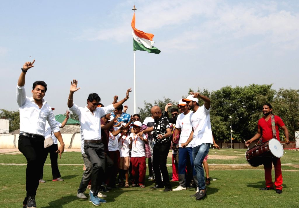 A flash mob pays tribute to Indian Army at Connaught Place in New Delhi on Oct 10, 2016. The flash mob was organised by  Acid Survivors Foundation, India.