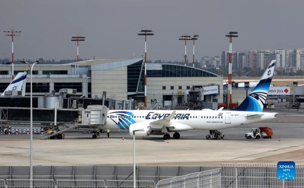 A flight of Egypt's flagship carrier EgyptAir lands at Ben Gurion Airport outside Tel Aviv, Israel on Oct. 3, 2021. (Photo by Gil Cohen Magen/Xinhua/IANS)