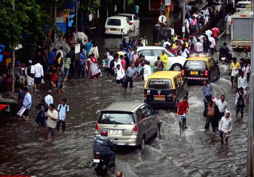 A flooded street of Mumbai after heavy rains in Mumbai on July 16, 2014.