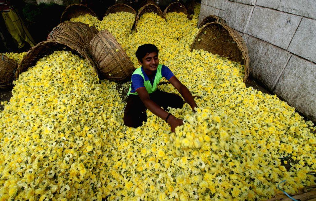 A flowers monger at Koyambedu market on Aayudha Pooja in Chennai, on Oct 8, 2016.