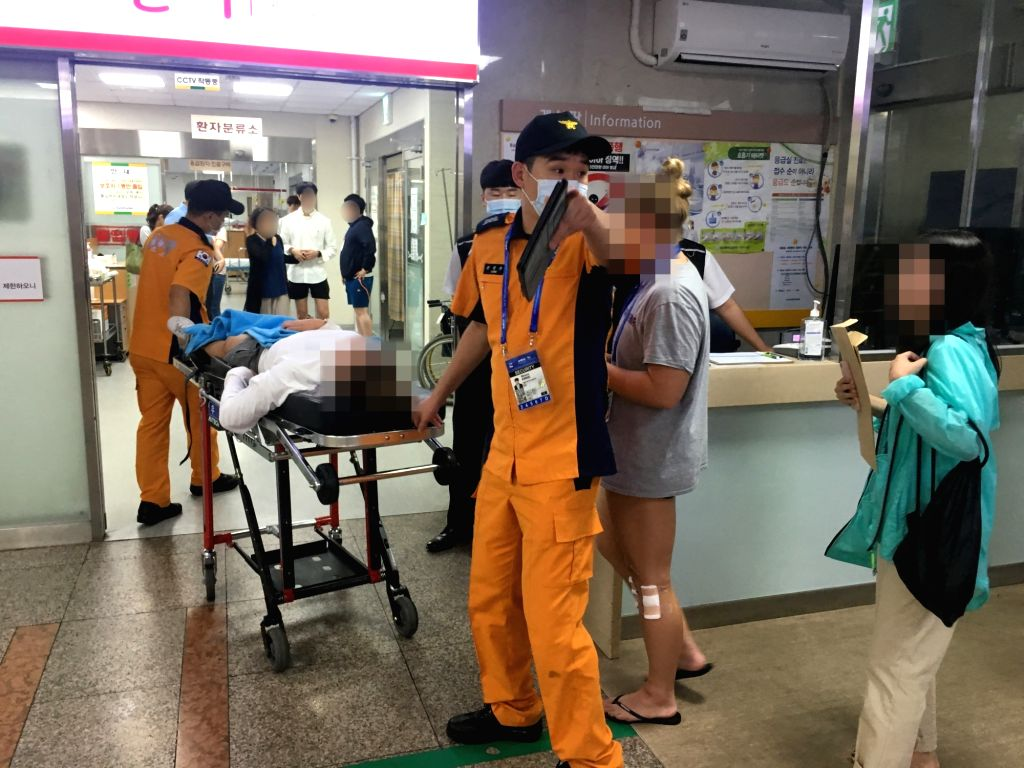 A foreign athlete in South Korea for the 18th FINA World Championships is taken to an emergency room at a hospital in Gwangju, some 330 kilometers south of Seoul, on a gurney after suffering ...