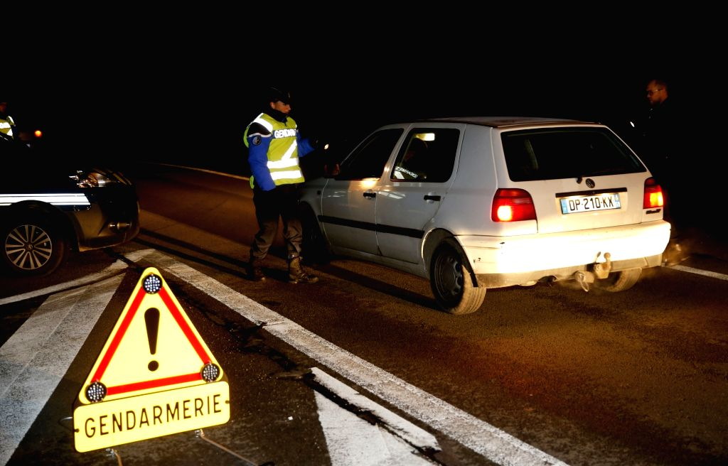 A French policeman checks a car leaving France at Belgian border city Bettignies, Nov. 14, 2015. Over 100 people have been reportedly killed and many more ...