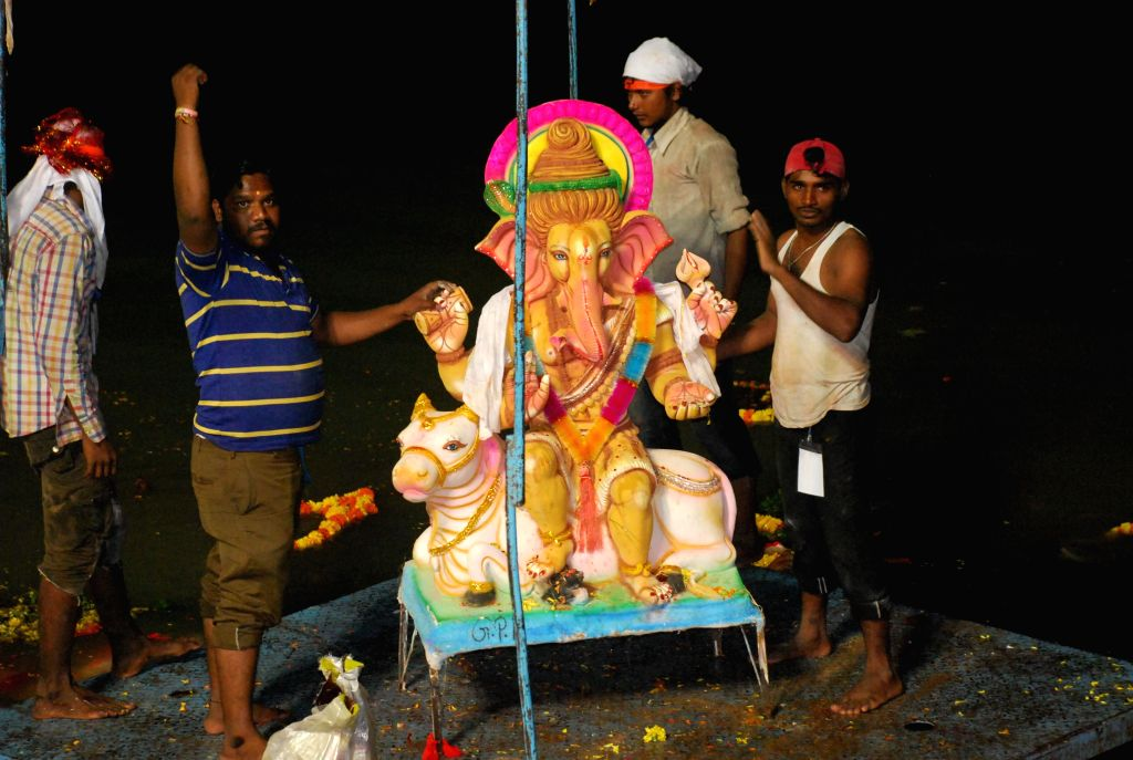 A Ganesh idol being immersed in the Hussain Sagar after Ganesh Festival in Hyderabad on Sept 7, 2014.