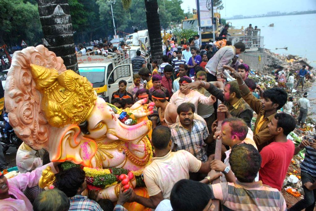 A Ganesh idol being immersed in the Hussain Sagar after Ganesh Festival in Hyderabad on Sept 8, 2014.