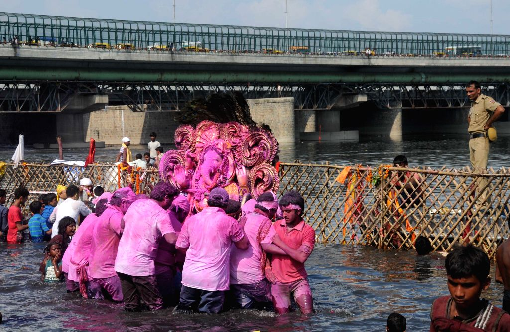 A Ganesh idol being immersed in Yamuna river after Ganesh Festival in New Delhi on Sept 8, 2014.