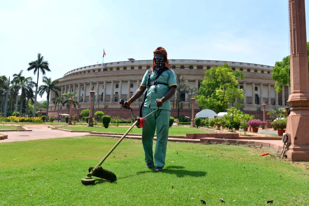 A gardener mows with string trimmer at Parliament during the extended nationwide lockdown imposed to mitigate the spread of coronavirus; on Apr 21, 2020.