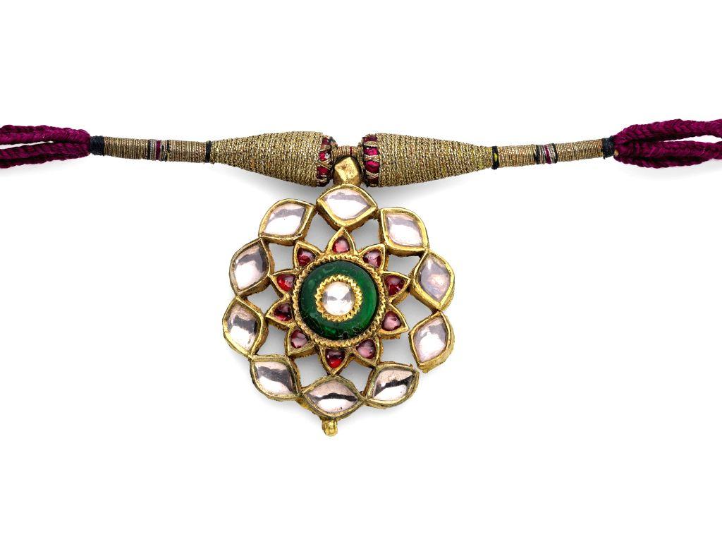 A Gem-Set Pendant, India, 19th century, est. £3,500-4,000.