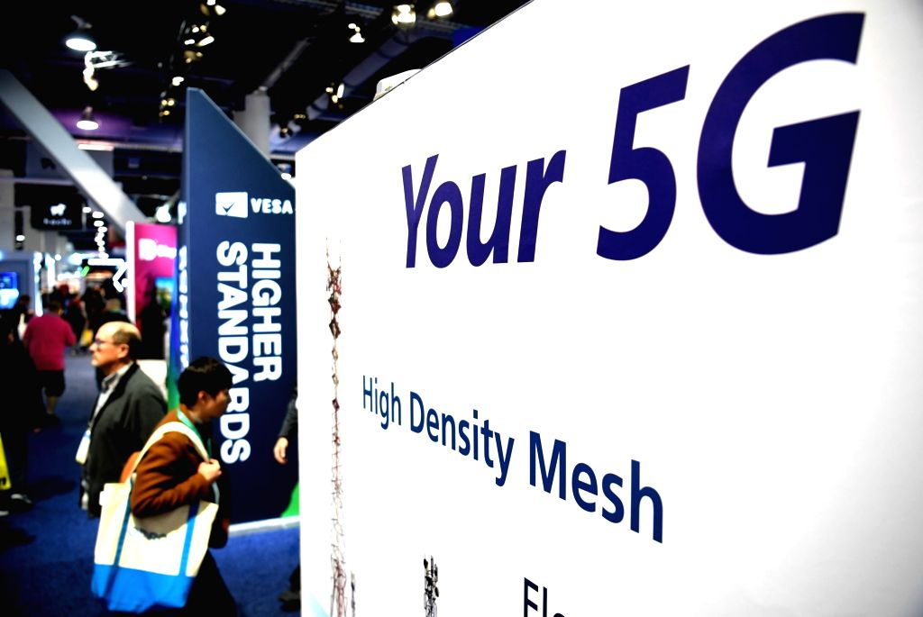 A giant 5G poster is seen at the 2020 Consumer Electronics Show in Las Vegas, the United States, Jan. 9, 2020. The annual tech show, which runs from Tuesday to ...