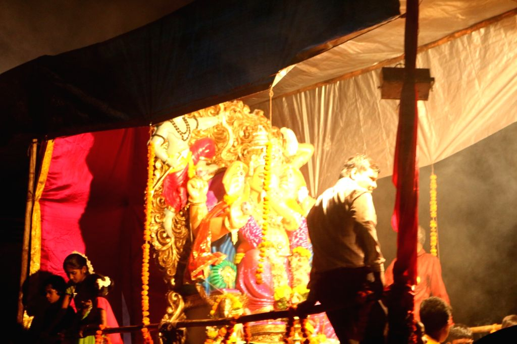 A gigantic idol of Hindu elephant-headed god Ganesh, being led to the Arabian Sea for immersion, in Mumbai, on Sep 15, 2016, after ten days of festivities and prayer.